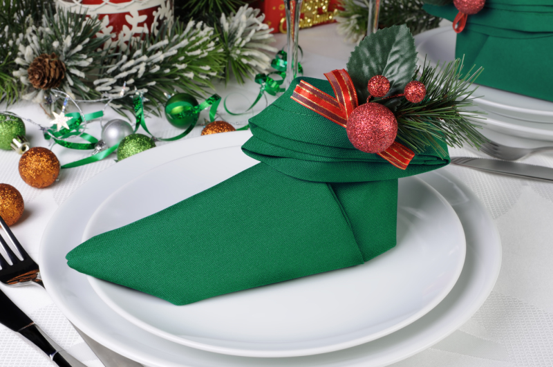 Christmas Table Setting With A Napkin In The Form Of Elven Boots