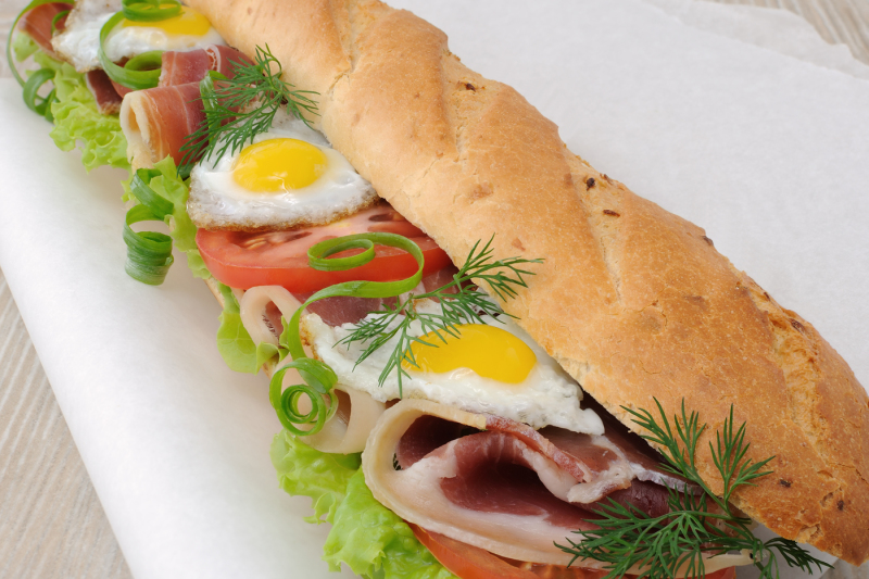 Big Sandwich With Ham Tomato And Fried Quail Egg By Food Of