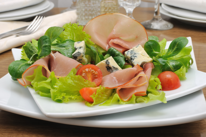 Appetizer With Ham And Blue Cheese In Lettuce Leaves With Corn