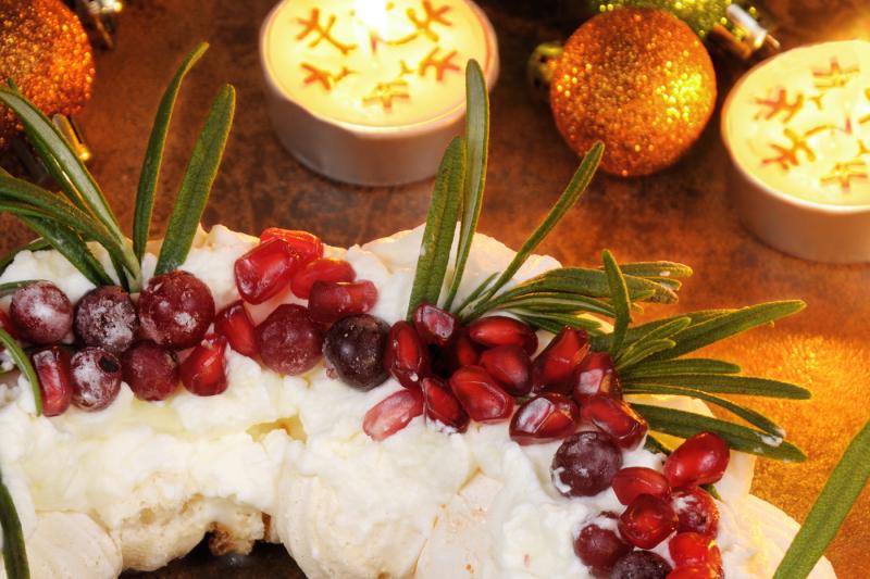 Christmas Wreath Made Of Meringue With Cream Pomegranate