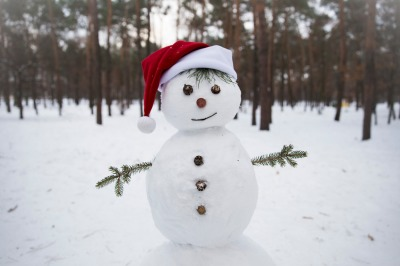 sculpture of a funny snowman dressed in a Santa Claus hat