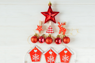 Christmas decorations laid out in the shape of a Christmas tree. Overhead view
