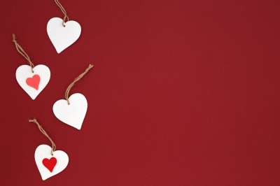 Valentine's background with white hearts on red.