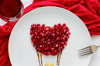 Art food concept. Air balloon with couple. Pancakes with pomegranate