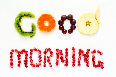 Art food concept. Text 'Good morning' from fruits.