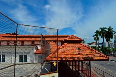 asian tropical campus school. orange roof. red shingles, tile, slate