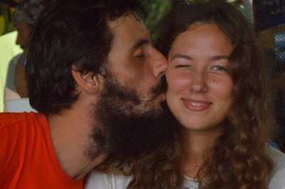 two young travelers, lovers feel first love. man kiss women on cheek