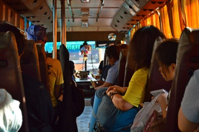 backpackers passengers travel on bus. summer excursion in Asia.