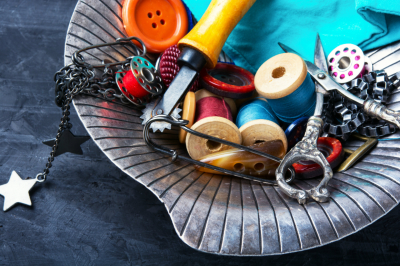 scissors, buttons for clothing and thread