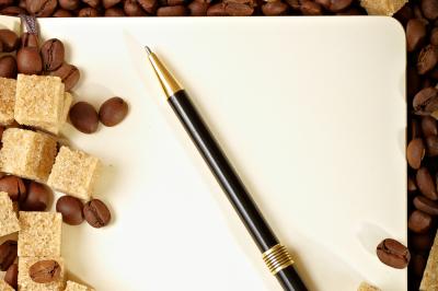Coffee beans, paper, pen