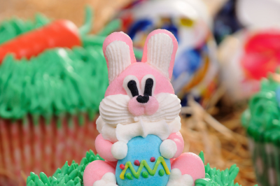 Muffin decorated Easter bunny sitting on the grass