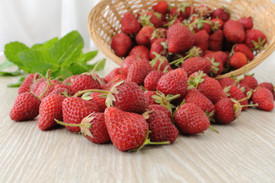 Ripe, juicy strawberries sprinkled on the table close-up