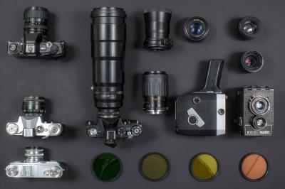 Vintage camera equipment on black background