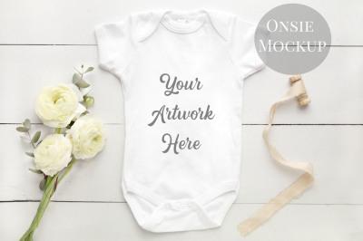 Babygrow, romper suit, onsie mockup with white renunculas