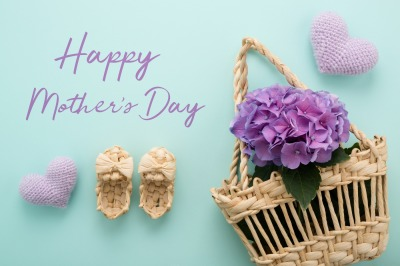 Flowers in a straw basket with text Happy Mother's Day