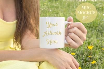 Woman holding mug - yellow dress
