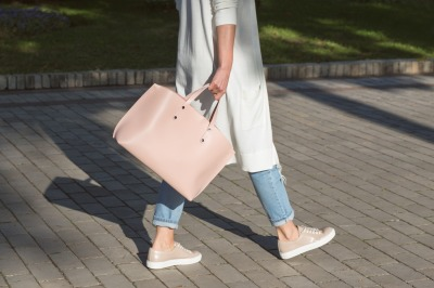 Casual Woman walking the street with bag in the morning