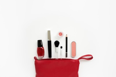 Red open cosmetic bag with makeup set