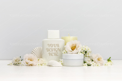 Cosmetics mockup with white flowers, bottle contain