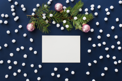 Snowy blue Christmas mockup with fir branch and pink Christmas balls