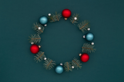 Christmas wreath of New Year's decorations & fir on dark green.