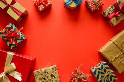 Top view on Christmas gifts wrapped in gift paper