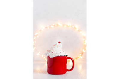 Red mug of hot drink with whipped cream
