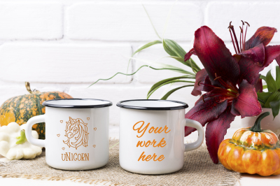 Two white campfire enamel mug mockup with pumpkin and lily.