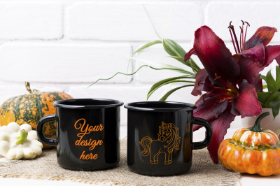 Two black campfire enamel mug mockup with pumpkin and red lily.