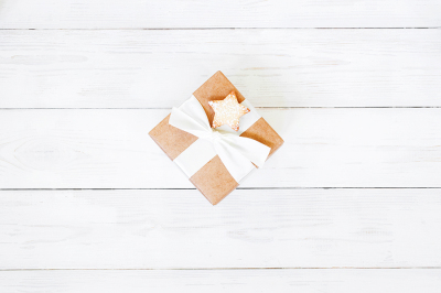 Gift box on the white wooden table