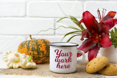 White campfire enamel mug mockup with cookie and red lily