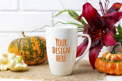 White coffee cappuccino mug mockup with pumpkin and red lily.