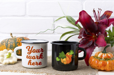 White and black campfire mug mockup with pumpkin and red lily.