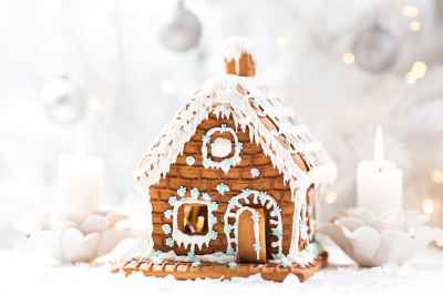 Gingerbread house on a light background with bokeh. New year card.