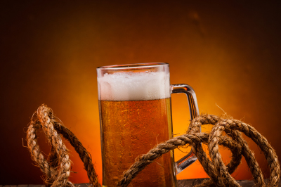Glass of beer on dark background