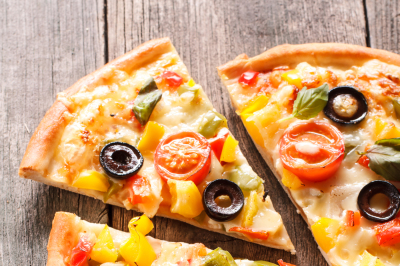 Home made pizza on wooden background. Fast food concept