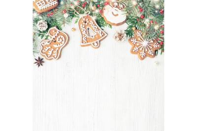 Christmas ornaments & Gingerbread cookies frame on white wood table wi