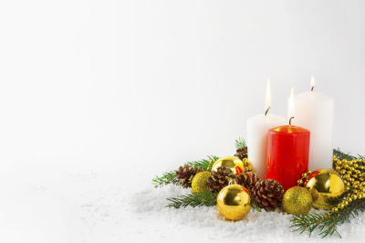 Christmas background with burning candles in snow.