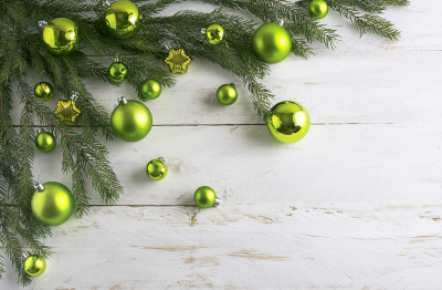Christmas background  decorated with green bauble hanging.
