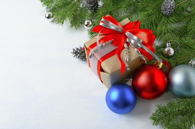 Christmas background with gift box, blue and red ornaments.