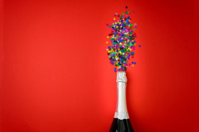 Bottle of champagne with star shape confetti