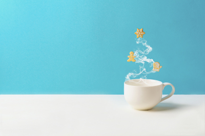 Cup of tea or coffee with steam in fir tree shape with gingerbread