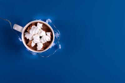 Hot chocolate with marsmallow candies decorated illumination light