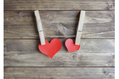 two red hearts hanging with clothespin on the rope. love concept