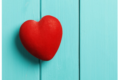 red heart on a blue wooden background