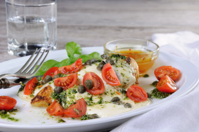 grilled chicken breast topped with melted mozzarella cheese, basil pe