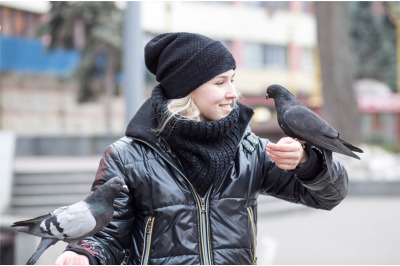young girl with pigeons