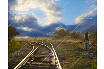 evening landscape with railroad rails