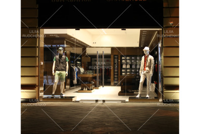 night shopwindow with men dressed mannequins