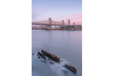 Aerial view on Queensboro bridge from East River at sunset